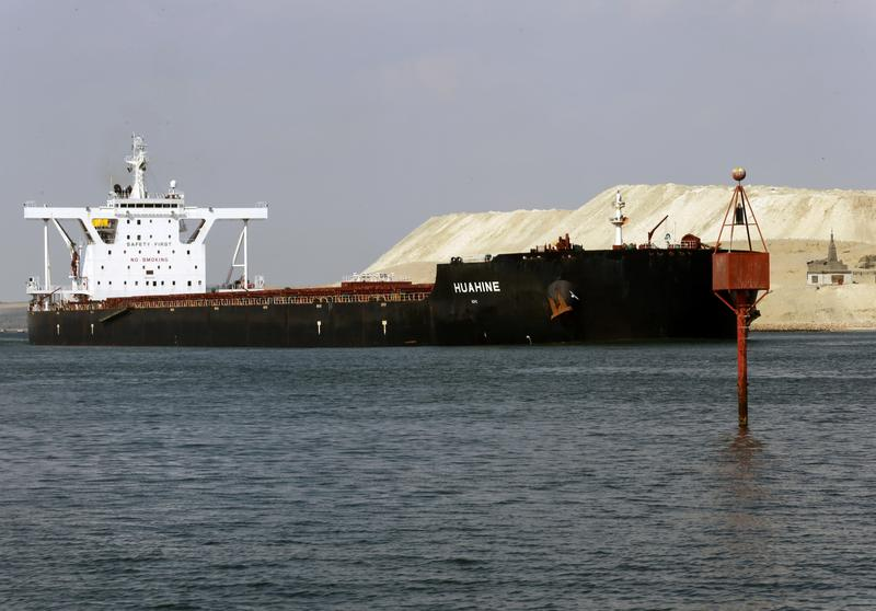 Suez Canal works to clear backlog as shipping convoys resume